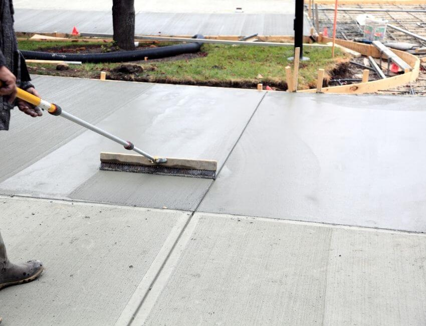 how thick should a concrete driveway be